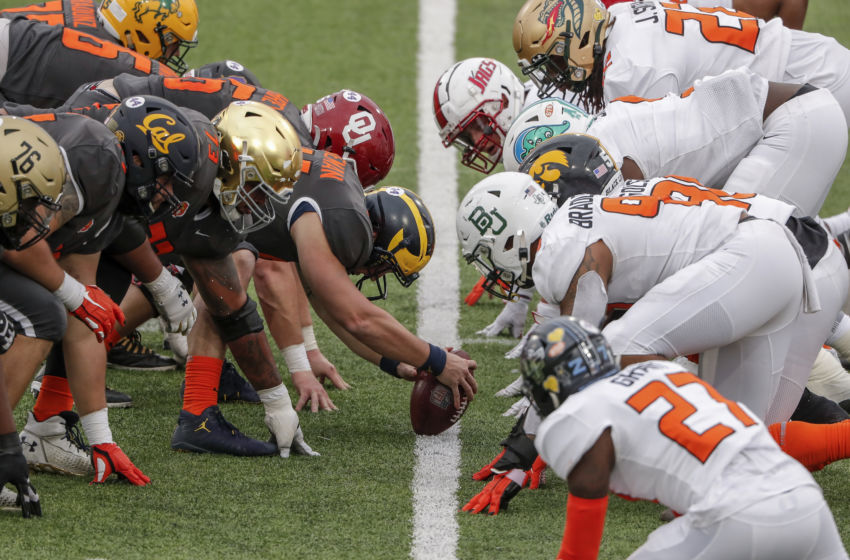 MOBILE, AL - JANUARY 30: A general view of the National Team at the line of scrimmage facing off against the American Team during the 2021 Resse's Senior Bowl at Hancock Whitney Stadium on the campus of the University of South Alabama on January 30, 2021 in Mobile, Alabama. The National Team defeated the American Team 27-24. (Photo by Don Juan Moore/Getty Images)